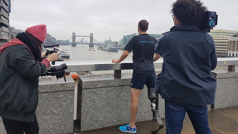 Andy Lewis MBE and video crew on London Bridge looking at Tower Bridge